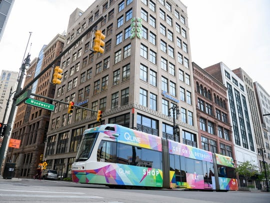 The QLine is a short rail system in Detroit that advocates hope could be extended or linked to the suburbs in a regional transit system.