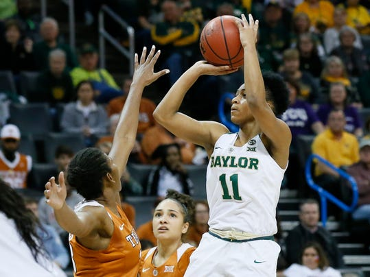 Baylor guard Alexis Morris (11) shoots over Texas guard Ariel Atkins, left, in the first half of an NCAA college basketball game in the championship game of the women's Big 12 conference tournament in Oklahoma City, Monday, March 5, 2018. (AP Photo/Sue Ogrocki)