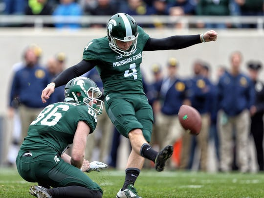 Michigan State's Michael Geiger, right, is a Toledo, Ohio native. He had the winning kick against Ohio State last season.