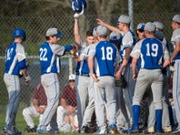 McConnellsburg's baseball team surrounds Weston Brunner, center, to celebrate his home run during a baseball game against Southern Fulton on Friday, April 28, 2017.  McConnellsburg won 7-6.