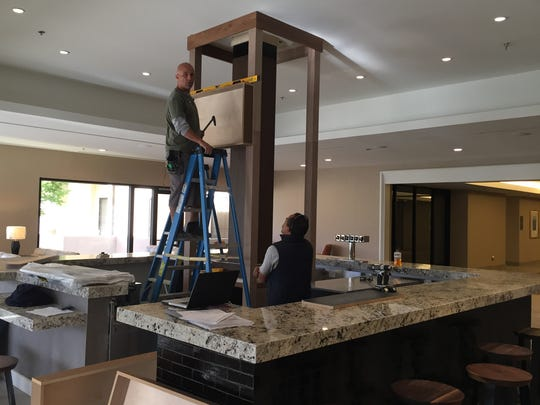 Workers complete the installation of the new bar at the Double Tree by Hilton in Cathedral City.