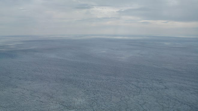 The Greenland ice sheet stretches out over an area more than twice the size of Texas in this photo taken July 31, 2013 from an Air National Guard LC-130 plane.
