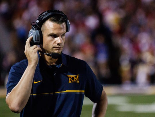 Kettle Moraine head coach Justin Gumm keeps an eye