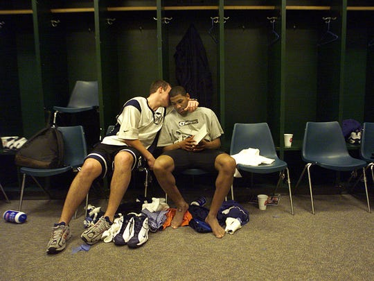 Butler player Jason Myers, left, consoled teammate LaVall Jordan in the locker room after their loss in the first round of the NCAA tournament. Butler lost on a last second shot to Florida 69-68. Jordan missed two free throws with 8.1 seconds left in overtime that might have won the game.