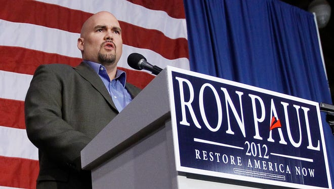In this Dec. 28, 2011, file photo, Kent Sorenson speaks at a rally for Rep. Ron Paul, R-Texas, at the Iowa State Fair Grounds in Des Moines.