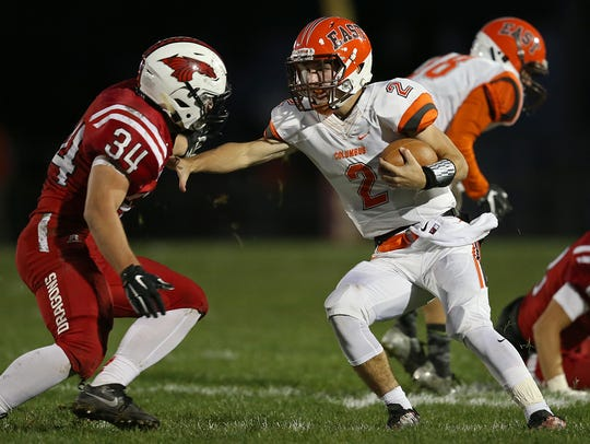 FILE – Columbus East's Josh Major (2) has the Olympians