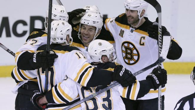 Jarome Iginla celebrates with his Bruins teammates during the 2013-14 season. Iginla, a longtime Calgary Flame who spent one season in Boston, headlines the Hockey Hall of Fame Class of 2020.