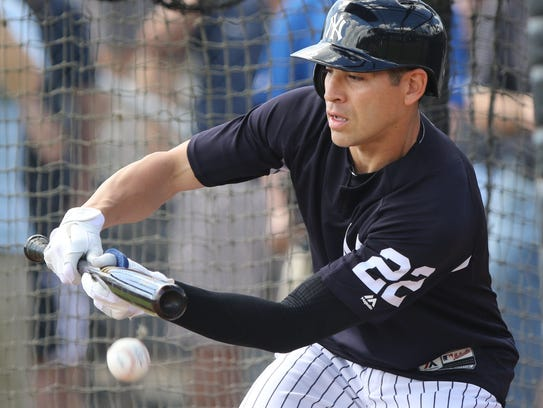 Jacoby Ellsbury lays down a bunt during batting practice.