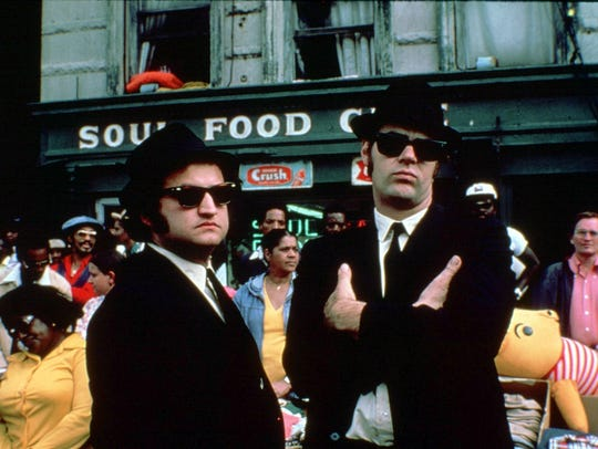 "John Belushi and Dan Aykroyd are ""The Blues Brothers."" A gigantic statue of Jake and Elwood Blues stands in front of the Two Rivers Inn in Dunnellon."