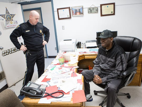 Somerset County Sheriff, Ronnie Howard, left, talks