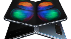 Two Galaxy Fold devices folded at an angle