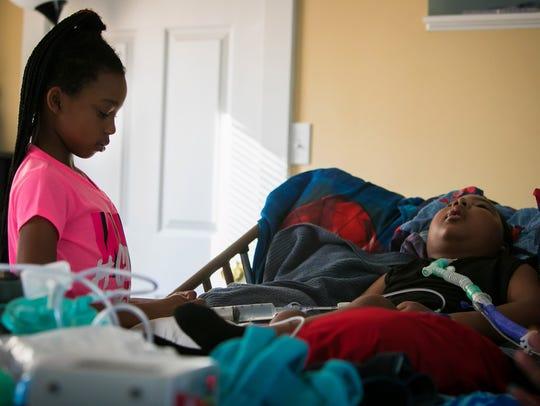 Josslynn Pott, 9, along with other siblings all help