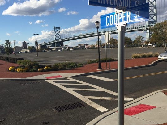 A parking lot at Cooper Street and Riverside Drive is the site of a proposed hotel on Camden's Waterfront.