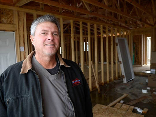 Farmer Jim Brown stands inside a house he's building in Chester. Brown devotes summers to grain farming and the offseason to building about one house a year with his Jim Brown Construction. He operates both businesses from his dining room table.