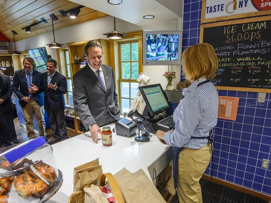 Gov. Andrew Cuomo purchases a jar of marinara sauce produced by McEnroe Organic Farm in Millerton at the Taste NY location at the Todd Hill rest area on the Taconic State Parkway.