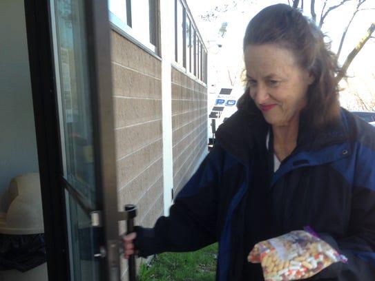 Stephanie Korcz of Burlington brings a bag of unused