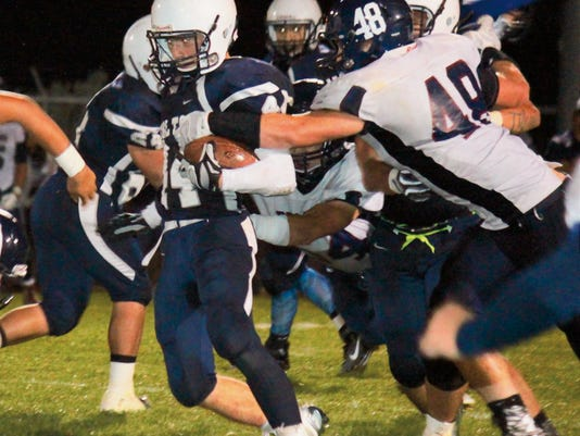 Danny Udero/Sun-News : Silver's Shawn Gutierrez carried the load at the running back position Friday night against Deming High. The Colts took a 14-13 lead into the locker room at halftime.