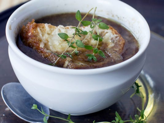 Slow Cooker Onion Soup topped with cheese is a delicious luxury as we head into fall and warm soup returns to the menu.