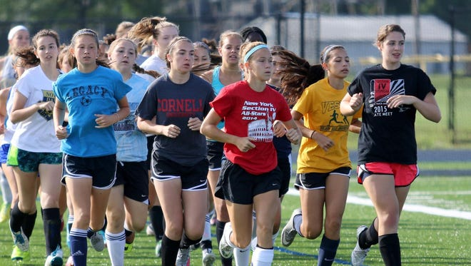 The Elmira Notre Dame girls soccer team runs during a preseason practice. The Crusaders return eight starters after winning the IAC South Large School title last season.