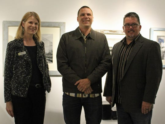 Kevin Husta (center) stands with Saskia Schmidt, interim director of Education/Noyes Museum of Art at Stockton University (left), and Michael Cagno, executive director of the Noyes Museum (right) at the opening of Husta's new exhibit in Kramer Hall.