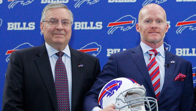In this Jan. 13, 2017, file photo, Buffalo Bills head coach Sean McDermott poses for a photograph with team owner Terry Pegula, left, during a press conference in Orchard Park, N.Y.