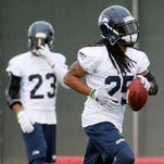 Seattle Seahawks' Richard Sherman run drills during a team practice for NFL Super Bowl XLIX football game, Wednesday, Jan. 28, 2015, in Tempe, Ariz. The Seahawks play the New England Patriots in Super Bowl XLIX on Sunday, Feb. 1, 2015.