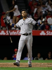 New York Yankees' Starlin Castro reacts after striking