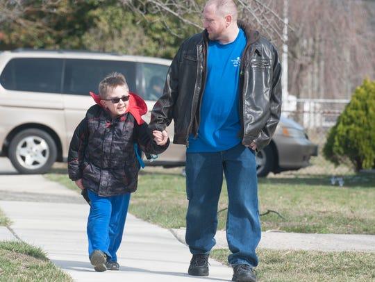 Riley and his dad, Darren O'Brien, walk home from school