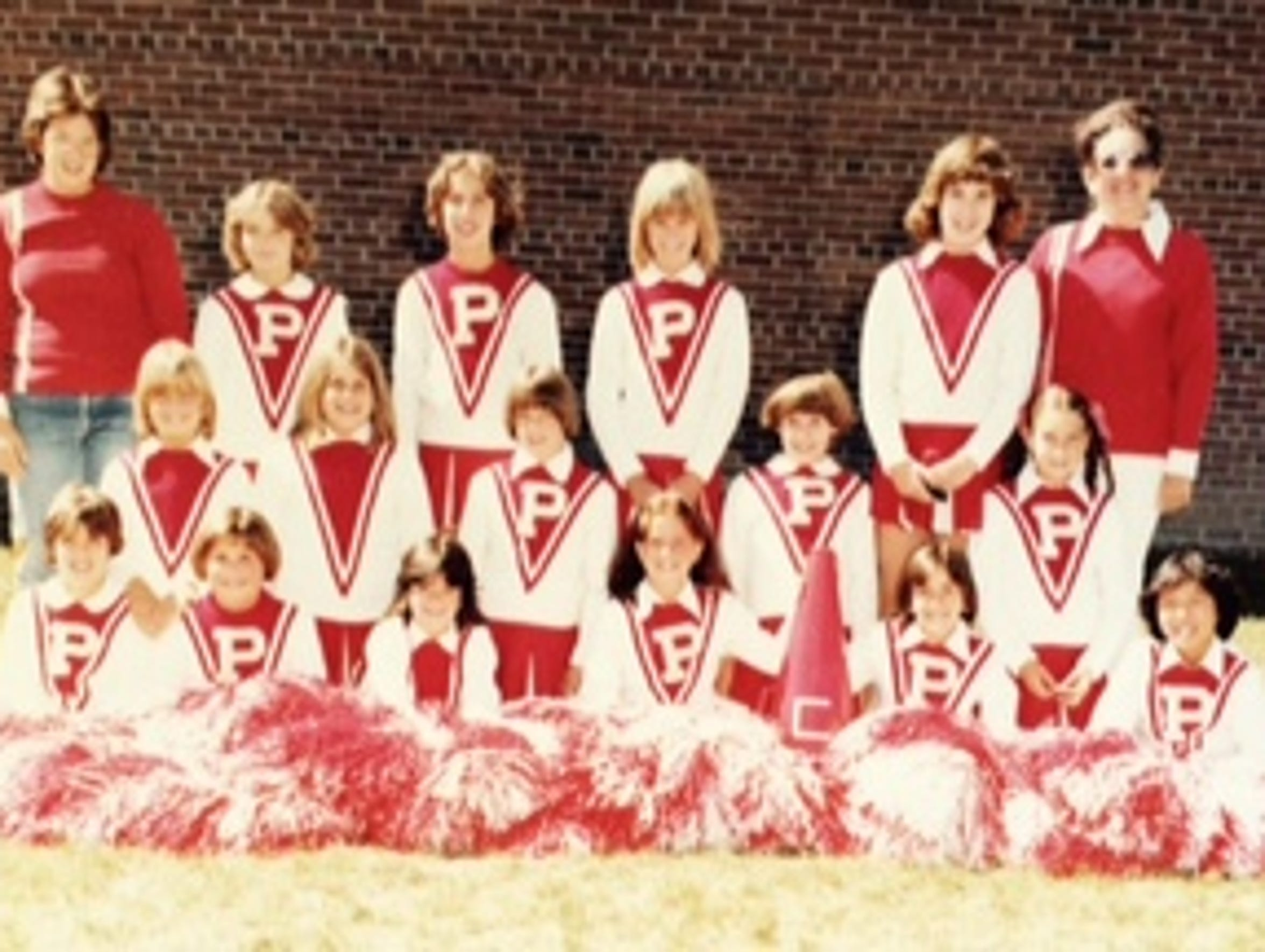 Kim Pegula, bottom right, with her youth cheerleading