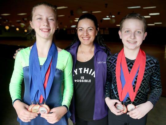 Kylie Root, left, coach Dezera Salas, and Gauge Phillips,