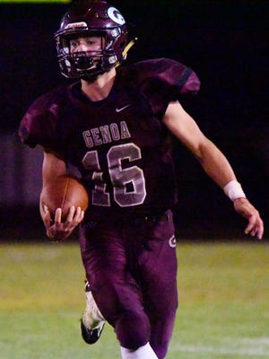 Genoa's Noah Edwards carries the football Friday against Woodmore.