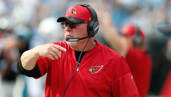 Arizona Cardinals head coach Bruce Arians motions to his players during the fourth quarter against the Carolina Panthers at Bank of America Stadium. The Panthers defeated the Cardinals 30-20.