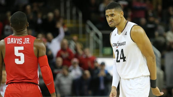 Cincinnati Bearcats forward Kyle Washington (24) reacts after scoring a basket and drawing a foul in the second half during the NCAA basketball game between the Houston Cougars and the Cincinnati Bearcats, Wednesday, Jan. 31, 2018, at BB&T Arena in Highland Heights, Ky. Cincinnati won 80-70.