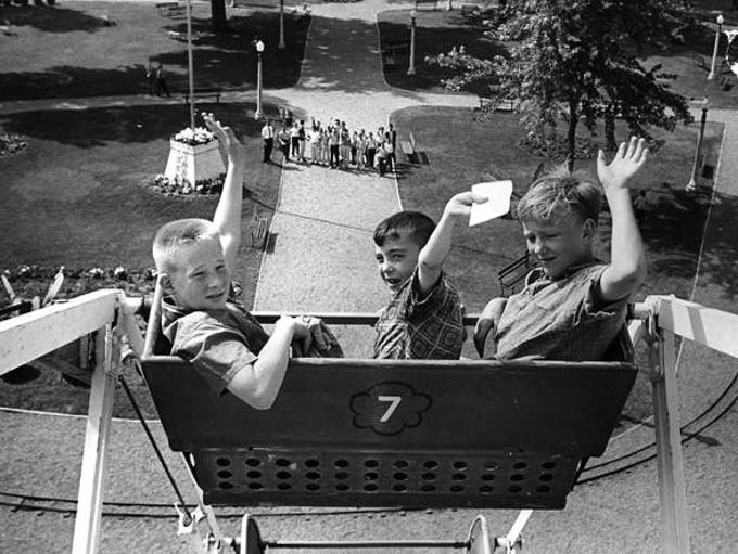 Randy Hartwig and Douglas Denton, both of Marshalltown, and Joe McChurch of Des Moines ride the ferris wheel at Riverview Park in 1964. About 2,000 Register and Tribune carrier salesmen were treated to a day at Riverview Park. Each carrier who produced five or more new orders on his route was eligible to attend.
