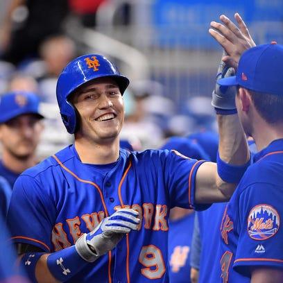 New York Mets left fielder Brandon Nimmo (9) celebrates