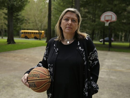 Amanda Jackson holds a basketball on April 28, 2017, that belonged to her son at a court in Olympia, Washington, where he used to play while growing up.