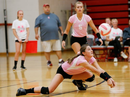 West Lafayette's Maddie Sheiss lunges for a dig against Central Catholic Wednesday, September 28, 2016, at West Lafayette High School. Central Catholic defeated West Lafayette 23-25, 25-23, 25-21, 25-13.