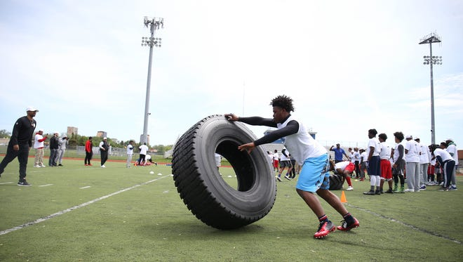 Barry Ginyard goes through drills during the Calvin Johnson Jr. Foundation Catch a Dream football camp held at Southfield high school Saturday, May 20, 2017 in Southfield.
