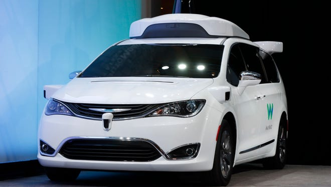 A Chrysler Pacifica hybrid outfitted with Waymo's suite of sensors and radar is shown at the North American International Auto Show in Detroit, Sunday, Jan. 8, 2017. , Waymo is the autonomous vehicle company created by Google's parent company, Alphabet. (AP Photo/Paul Sancya)