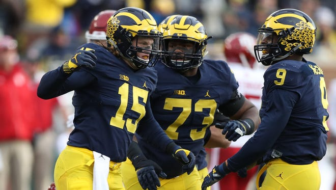 Michigan's Chase Winowich celebrates after sacking Indiana QB Richard Lagow during first half action Saturday.