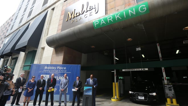 Chinedum Ndukwe, a developer with Kingsley Wells Enterprises, speaks at the grand opening of the Mabley Garage on Fourth Street.