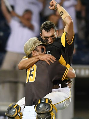 East Union pitcher Joel Wilkinson and Jacob Raines celebrate after the Urchins win the 2A state title.