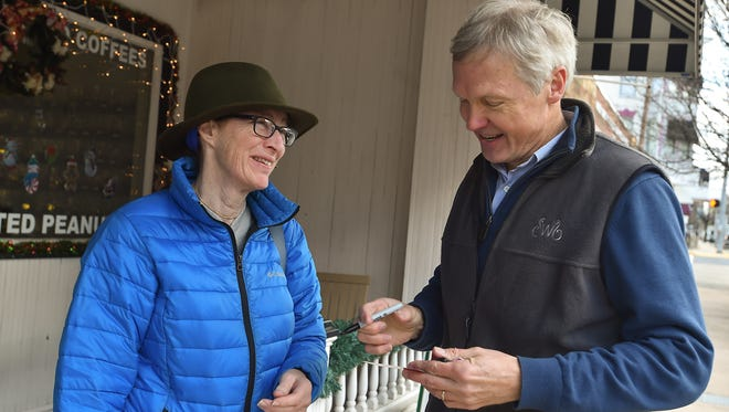 Sal Dobbs, left, talks with Art Halvorson, right, as he goes door to door to talk with voters in Greencastle, Pa. on Saturday, Dec. 19, 2015. Halvorson is running against U.S. Rep. Bill Shuster in the GOP primary 2016.
