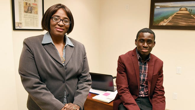 Counselors Oluwatoyin Adetunji and Emmanuel Oppong describe the services they will offer at Recover Health Resources Wednesday, Feb. 3, in St. Cloud.