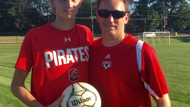 Cinnaminson senior soccer player Pat McCarthy with Pirates coach Jason Meile