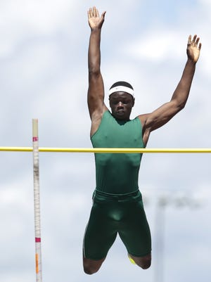Rashid Coulibaly, of Oshkosh North, clears the bar on a pole vault attempt at the WIAA State Track and Field Meet on Saturday.