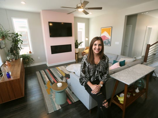 Molly Sanjule is one of the first to live in the new Charlotte Square townhouses in downtown Rochester.