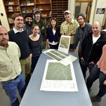 Maps made by Kevin McManigal's cartography students at the University of Montana are the most detailed topographic records ever produced of tiger habitat in the Parsa Wildlife Preserve in Nepal. From left, Hugh Robinson of wild cat conservation organization Panthera, students Garin Wally, Amy Lippus, Bryan Tutt, Patrick Warner, Verena Henners, lecturer Kevin McManigal, and students Aaron Kamoske, James Fivecoats and Abby Isaac stand with some of the maps.