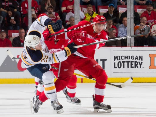 Detroit left wing Tomas Nosek checks Buffalo defenseman