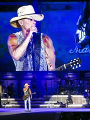Kenny Chesney performs during the Spread the Love Tour